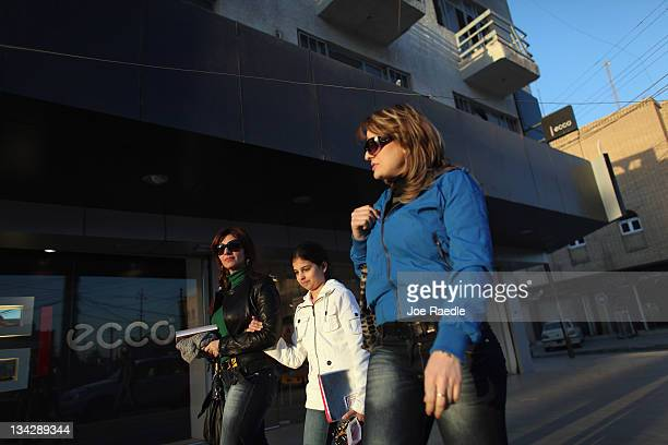 Women walk down the street as they visit stores on a shopping excursion on November 30 2011 in Baghdad Iraq Iraq is transitioning as the US military...