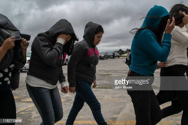 Women walk from the airport tarmac after being deported from the United States on May 30, 2019 in Guatemala City, Guatemala. U.S. Immigration and...