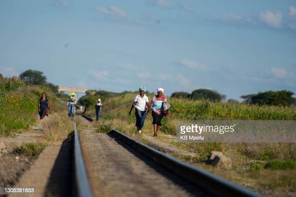 Women walk from the Emakhandeni suburb to the Cowdray Park suburb on March 4, 2021 in Bulawayo, Zimbabwe. Despite its perennial water troubles, the...
