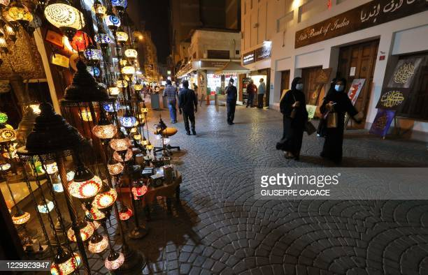 Women walk in the Old Manama Souq area in the Bahraini capital on December 1, 2020.