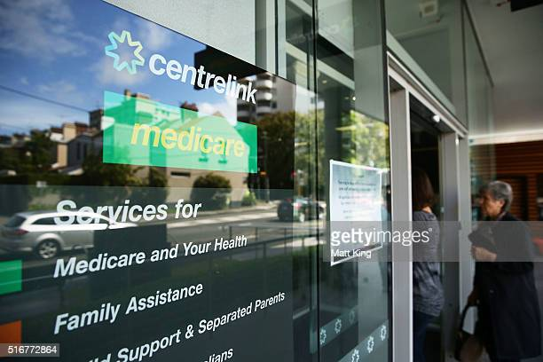 Women walk into a Medicare and Centrelink office at Bondi Junction on March 21 2016 in Sydney Australia Federal public sector workers are expected to...