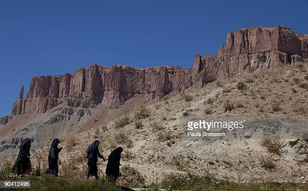 Women walk on a trail to a lake at BandEAmir National Park September 6 2009 in BandEAmir Afghanistan Located in the province of the Bamiyan Buddhas...