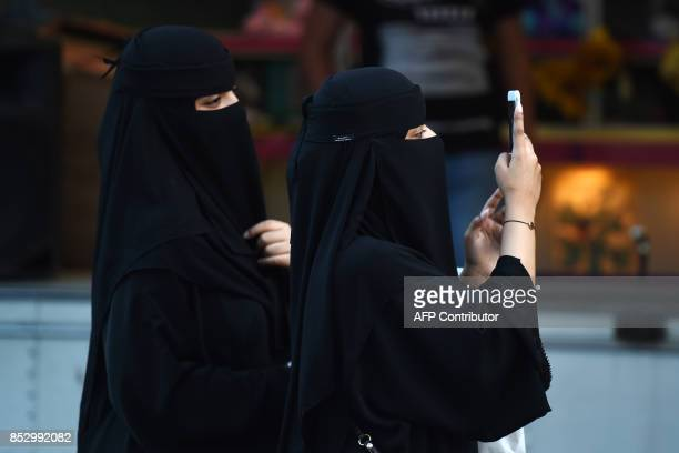 Women walk on Tahlia street in the Saudi capital Riyadh on September 24 during celebrations for the anniversary of the founding of the kingdom / AFP...