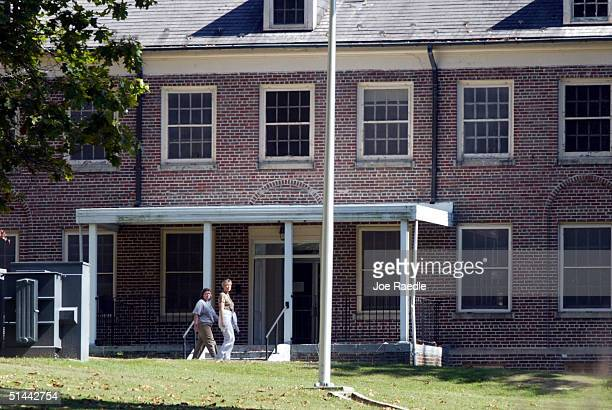 Women walk on the grounds near a building at the Alderson Federal Prison Camp where Martha Stewart turned herself in October 8 2004 in Alderson West...