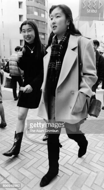 Women walk on the street on February15 1992 in Tokyo Japan