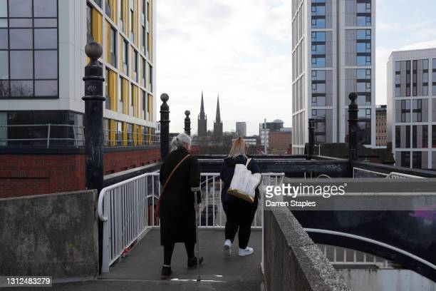 Women walk over the Canal Basin bridge towards the city as it prepares for the UK City of Culture events on April 14, 2021 in Coventry, England. Each...