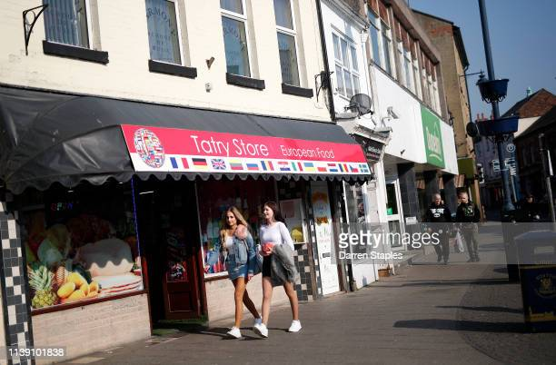 Women walk past a European grocery store on March 29 2019 in Boston England The town of Boston in Lincolnshire voted with a 75% majority to leave the...