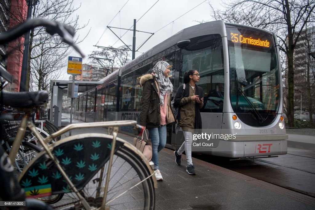 Women walk past a tram on February 22, 2017 in Rotterdam, Netherlands. The Dutch will vote in parliamentary elections on March 15 in a contest that, according to some polls, is currently led by far-right candidate Geert Wilders, the leader of the anti-Islam Party for Freedom (PVV). The Dutch election is the first of three prominent Eurozone elections with Germany heading to the polls on September 24 and the first round of the French presidential elections taking place on April 23.