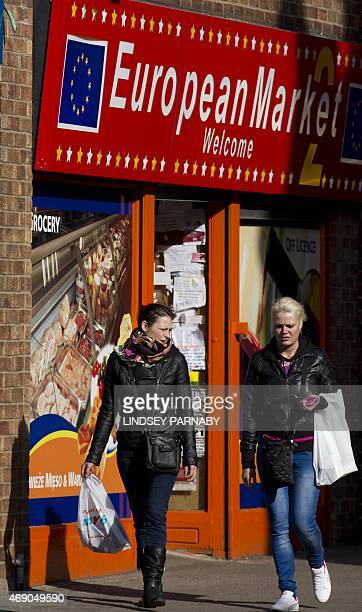 Women walk past an Eastern European food shop in the market town of Boston in Lincolnshire on March 5 2015 For centuries the town of Boston in...