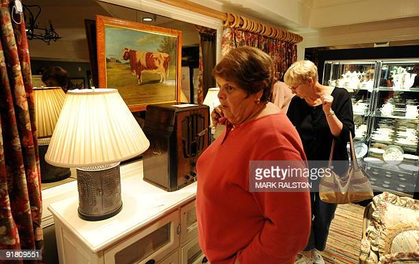 Women walk past household items that belong to Hollywood icon Barbra Streisand during an auction preview in Beverly Hills on October 12 2009 Hundreds...