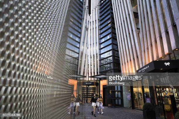 Women walk past luxury stores in the Omotesando area of Tokyo Japan on Tuesday Aug 21 2018 Japan is scheduled to release February's Consumer Price...