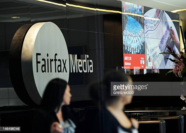 Women walk past signage in the foyer of the Sydney office of Fairfax Media on June 18 2012 Fairfax said June 18 it will slash 1900 jobs and erect...