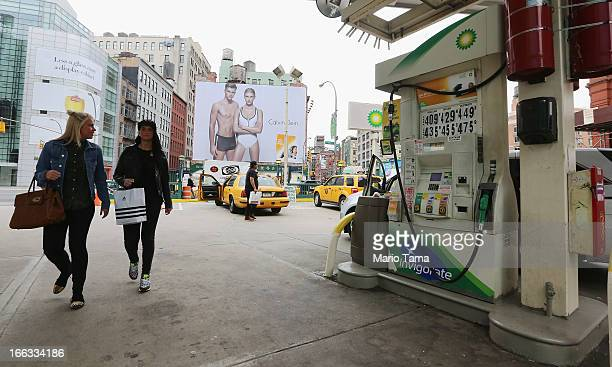 Women walk past the BP gas station at the iconic SoHo location of Houston and Lafayette streets on April 11 2013 in New York City The city's Landmark...