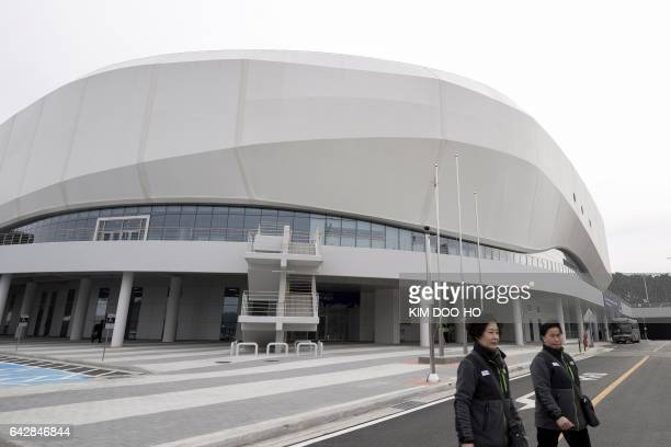 Women walk past the Gangneung Ice Arena the venue for the Figure Skating and Short Track Speed Skating for the upcoming PyeongChang 2018 Winter...