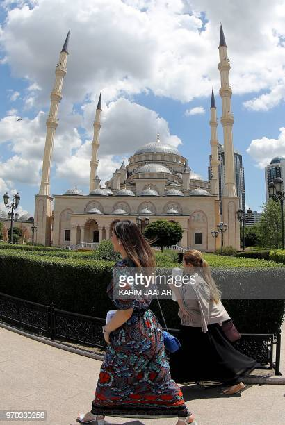Women walk past the Heart of Chechnya Akhmad Kadyrov Mosque in Grozny on June 9 ahead of the Russia 2018 World Cup