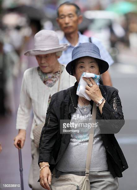 Women walk through a shopping district in Tokyo Japan on Thursday Aug 16 2012 With 7 million baby boomers starting to retire this year and about...