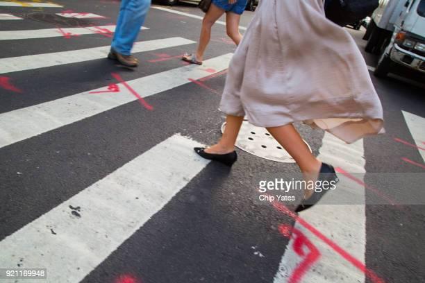 women walk through crosswalk - pink pants stock pictures, royalty-free photos & images