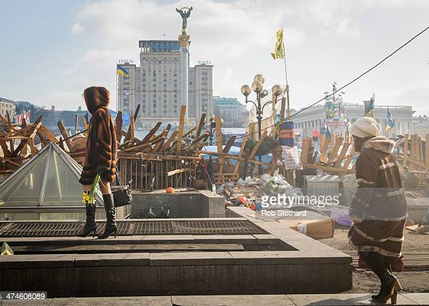Women walk through Independence Square on February 24 2014 in Kiev Ukraine Ukrainian interim interior minister has today announced that an arrest...