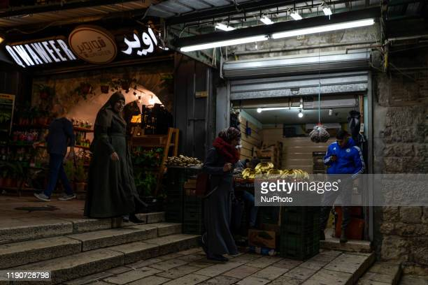 Women walk through the posts of the Muslim quarter in the old city of Jerusalem Israel on 10 December 2019