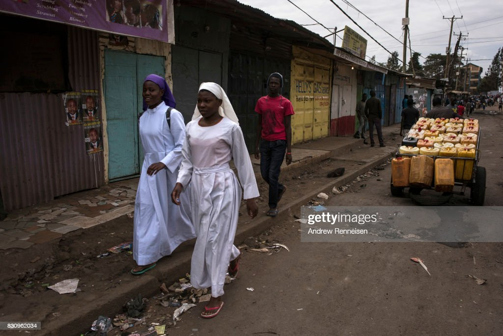 Women walk to church in the Kibera slum on August 13, 2017 in Nairobi, Kenya. A day prior, demonstrations turned violent in some areas throughout Kenya after Uhuru Kenyatta was named to his second term in Kenya's 2017 presidential election.