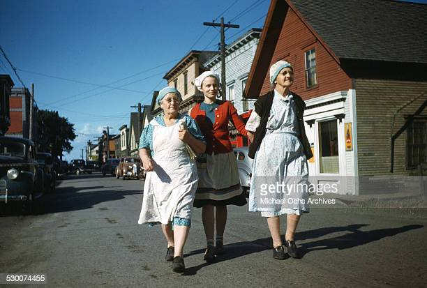 Women walk to the sardine cannery in Lubec Maine