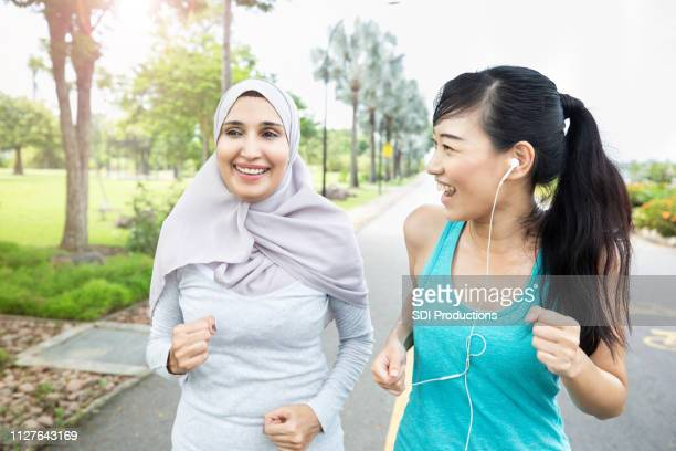 Women walk together in a park