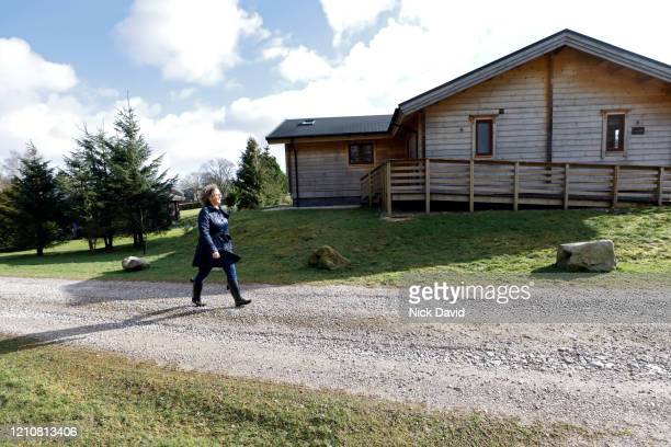 a women walking along a country path on a sunny day in the north of england. - femalefocuscollection stock pictures, royalty-free photos & images