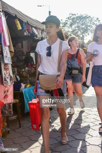 women walking at almaty bazaar - sergio amiti stock pictures, royalty-free photos & images