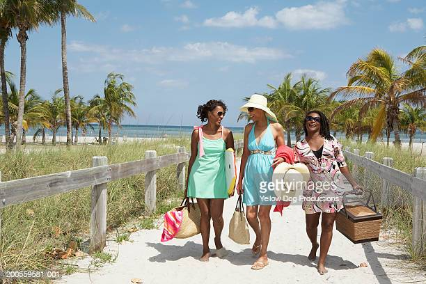 women walking at beach - celebration fl stock pictures, royalty-free photos & images