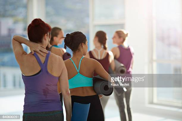 Women walking away after yoga class