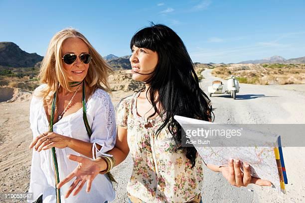 Women walking away from motorbike