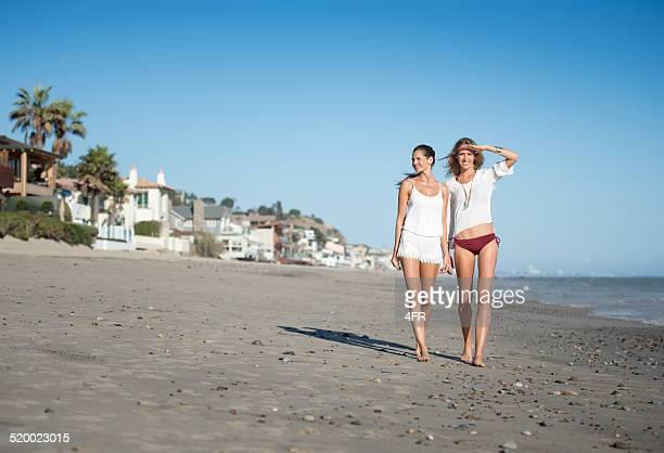 women walking down malibu beach, california - malibu beach stock pictures, royalty-free photos & images