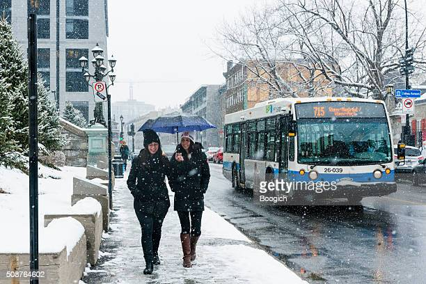 Women Walking in Cold Snowing Weather Montreal Canada City Scene