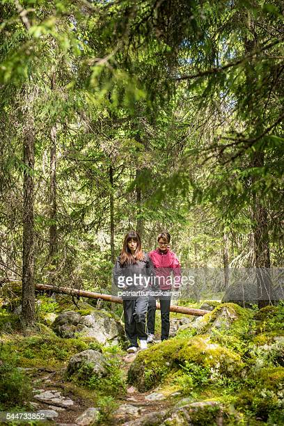Women walking in forest.