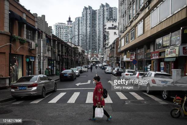 A women walking in the street on April 11 2020 in Wuhan Hubei Province ChinaDespite the partial lift of the 76 day long lockdown on April 8 Wuhan...