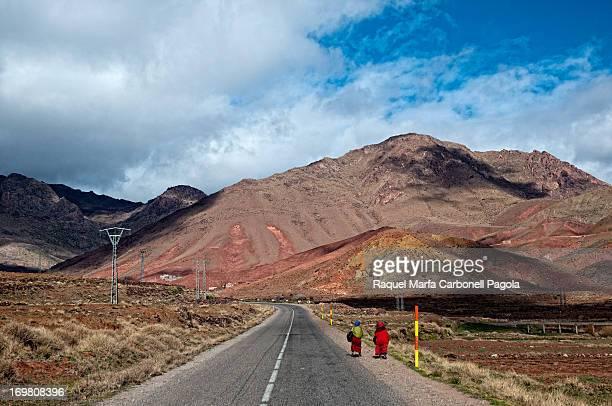 Women walking on a road through High Atlas mountains. Morocco,2013