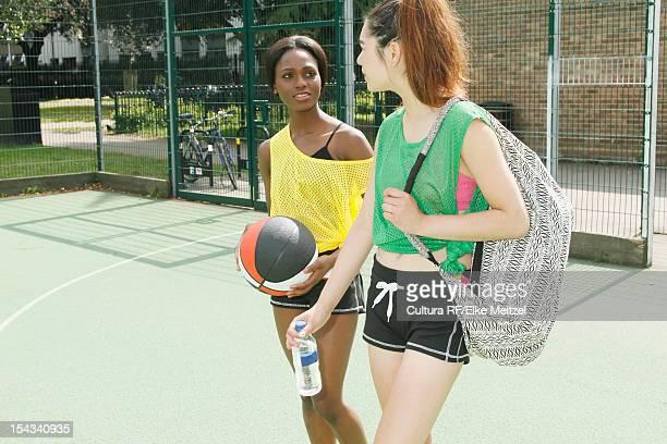 Women walking on basketball court