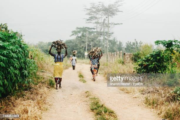 women walking on road - ghana stock pictures, royalty-free photos & images