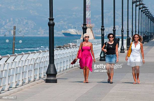 women walking on the cornice in beirut, lebanon - lebanese ethnicity stock photos and pictures