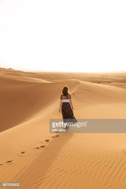women walking on the dune - merzouga stock pictures, royalty-free photos & images
