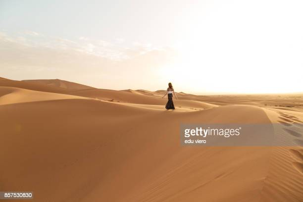 women walking on the sunrise - merzouga stock pictures, royalty-free photos & images