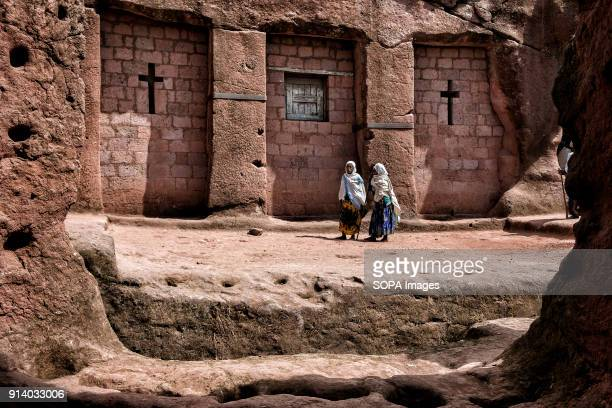Women walking outside the Biete Qeddus Mercoreus During the first days of January thousands of Ethiopian Orthodox Christian pilgrims go to the city...