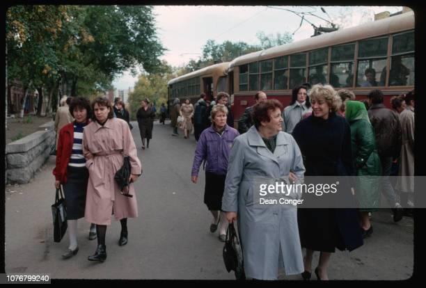 Women Walking Past Buses in Khabarovsk