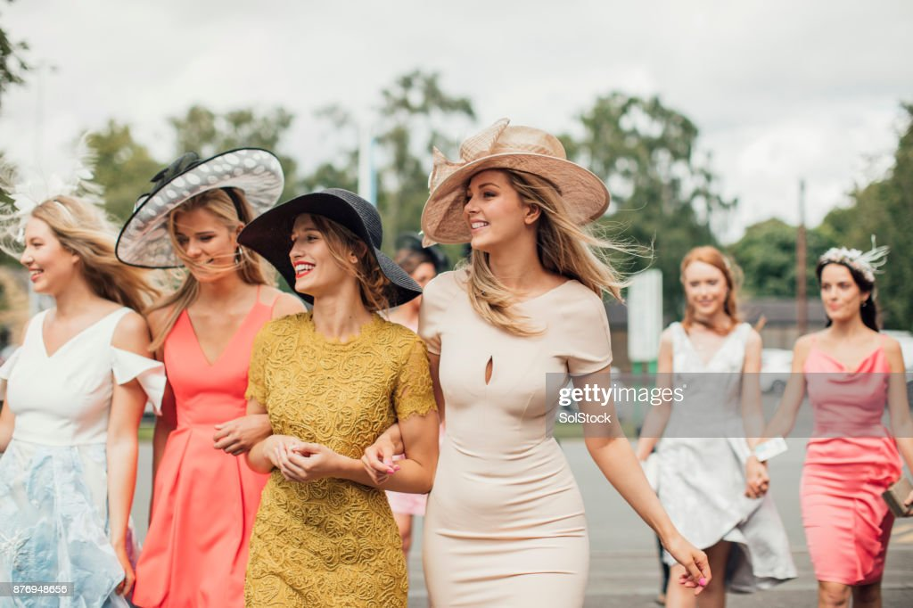 Women Walking to Racecourse : Stock Photo