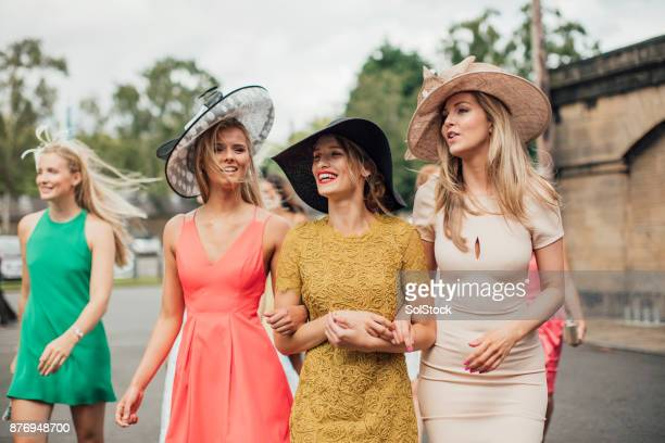 women walking to racecourse - newcastle races stock photos and pictures