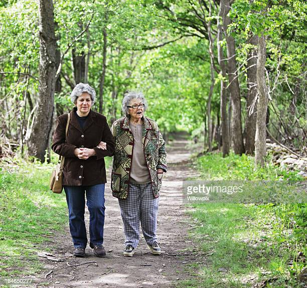 Women Walking Together on Nature Trail