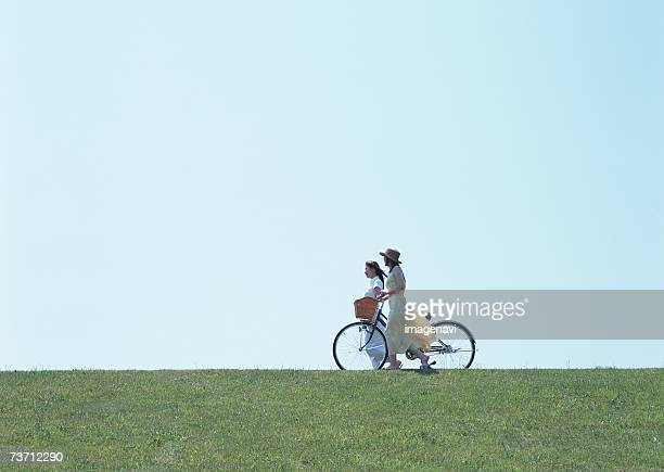 Women walking with bicycle