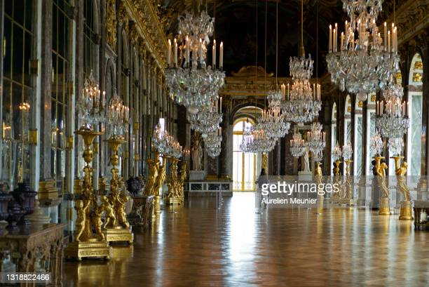 Women walks by herself in the hall of mirrors during the reopening of Chateau de Versailles on May 19, 2021 in Versailles, France. The country is...