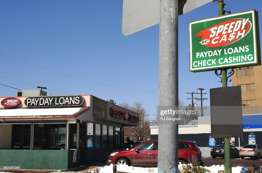 A women walks into Speedy Cash on February 21, 2018 in Lakewood, Colorado.