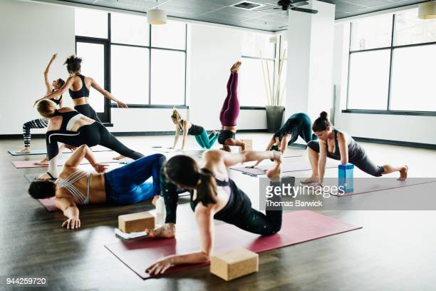 Women warming up for hot yoga class in fitness studio